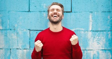 Man lifting his arms up happy about his success
