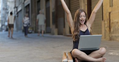 Very happy women watching her good goal-setting results on her laptop